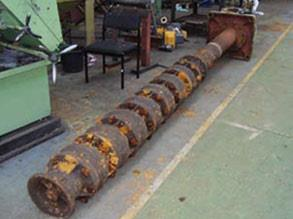 Cooling water pump with a damaged drive shaft waiting to be dismantled